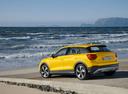 Фото авто Audi Q2 1 поколение, ракурс: 135 цвет: желтый