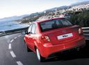 Фото авто Kia Rio 2 поколение [рестайлинг], ракурс: 180 цвет: красный