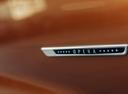 Фото авто DS 7 1 поколение, ракурс: шильдик цвет: бронзовый