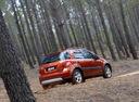 Фото авто Suzuki SX4 1 поколение, ракурс: 225 цвет: оранжевый