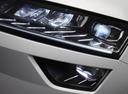Фото авто Skoda Karoq 1 поколение, ракурс: передние фары цвет: белый