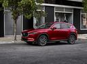 Фото авто Mazda CX-5 2 поколение, ракурс: 45 цвет: красный