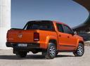 Фото авто Volkswagen Amarok 1 поколение, ракурс: 225 цвет: оранжевый