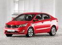 Фото авто Kia Rio 3 поколение, ракурс: 45 цвет: красный