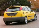 Фото авто Ford Focus 1 поколение [рестайлинг], ракурс: 225 цвет: желтый