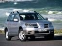 Фото авто Mitsubishi Outlander 1 поколение, ракурс: 315 цвет: серебряный