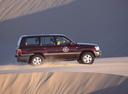 Фото авто Toyota Land Cruiser J100, ракурс: 270 цвет: бордовый