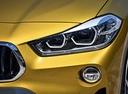 Фото авто BMW X2 F39, ракурс: передние фары цвет: золотой