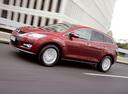 Фото авто Mazda CX-7 1 поколение, ракурс: 45 цвет: красный