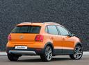 Фото авто Volkswagen Polo 5 поколение, ракурс: 225 цвет: оранжевый