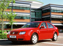 Фото авто Volkswagen Bora 1 поколение, ракурс: 45 цвет: красный