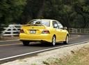 Фото авто Mitsubishi Lancer IX, ракурс: 225 цвет: желтый