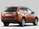 Фото авто Mitsubishi Outlander 3 поколение, ракурс: 225 цвет: оранжевый