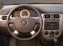 Фото авто Suzuki Forenza 1 поколение [рестайлинг], ракурс: рулевое колесо