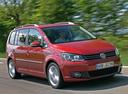Фото авто Volkswagen Touran 1 поколение [2-й рестайлинг], ракурс: 315 цвет: красный