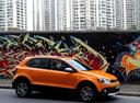 Фото авто Volkswagen Polo 5 поколение, ракурс: 270 цвет: оранжевый