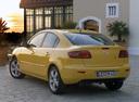 Фото авто Mazda 3 BK, ракурс: 135 цвет: желтый
