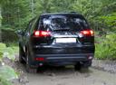 Фото авто Mitsubishi Pajero Sport 2 поколение [рестайлинг], ракурс: 180 цвет: черный