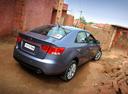 Фото авто Kia Cerato 2 поколение, ракурс: 225 цвет: серый