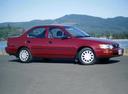 Фото авто Toyota Corolla E100, ракурс: 270 цвет: красный