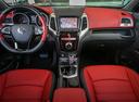 Фото авто SsangYong Tivoli 1 поколение, ракурс: торпедо цвет: красный