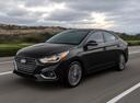 Фото авто Hyundai Solaris 2 поколение, ракурс: 45 цвет: черный