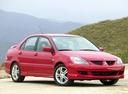 Фото авто Mitsubishi Lancer IX, ракурс: 315 цвет: красный