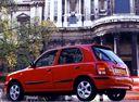 Фото авто Nissan March K11 [рестайлинг], ракурс: 135 цвет: красный