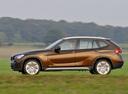 Фото авто BMW X1 E84, ракурс: 90 цвет: коричневый