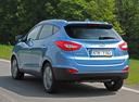 Фото авто Hyundai ix35 1 поколение [рестайлинг], ракурс: 135 цвет: голубой