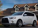 Фото авто Mitsubishi Outlander XL [рестайлинг], ракурс: 45 цвет: белый