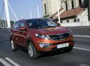 Фото авто Kia Sportage 3 поколение, ракурс: 315 цвет: оранжевый
