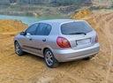 Фото авто Nissan Almera N16, ракурс: 135 цвет: серебряный