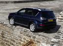 Фото авто Mitsubishi Outlander XL [рестайлинг], ракурс: 135 цвет: синий