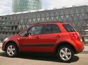 Фото авто Suzuki SX4 1 поколение [рестайлинг], ракурс: 90 цвет: красный