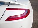 Фото авто Aston Martin Vanquish 2 поколение, ракурс: задние фонари цвет: белый