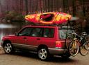 Фото авто Subaru Forester 1 поколение, ракурс: 135 цвет: красный