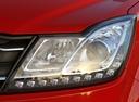 Фото авто SsangYong Korando 3 поколение [2-й рестайлинг], ракурс: передние фары цвет: красный