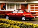 Фото авто Toyota Corolla E100, ракурс: 135 цвет: красный