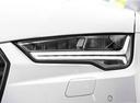 Фото авто Audi A7 4G [рестайлинг], ракурс: передние фары цвет: белый
