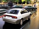 Фото авто Subaru Outback 2 поколение, ракурс: 225 цвет: белый