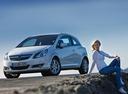 Фото авто Opel Corsa D, ракурс: 45 цвет: белый