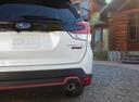 Фото авто Subaru Forester 5 поколение, ракурс: задняя часть цвет: белый