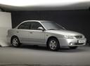 Фото авто Kia Spectra 1 поколение [рестайлинг], ракурс: 270 цвет: серебряный