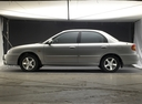 Фото авто Kia Spectra 1 поколение [рестайлинг], ракурс: 90 цвет: серебряный