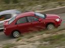 Фото авто Kia Cerato 1 поколение, ракурс: 270 цвет: красный