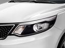 Фото авто Kia Rio 3 поколение [рестайлинг], ракурс: передние фары цвет: белый