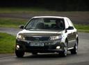 Фото авто Kia Magentis 2 поколение [рестайлинг], ракурс: 45 цвет: коричневый