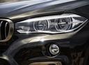 Фото авто BMW X6 F16, ракурс: передние фары цвет: коричневый