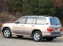 Фото авто Toyota Land Cruiser J100 [рестайлинг], ракурс: 135 цвет: бежевый